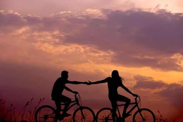 Couple Supporting Each Other Bicycles